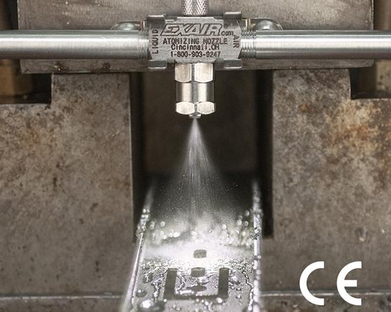 Boquilla Atomizadora de líquidos Exair aplica un tratamiento a una pieza maquinada